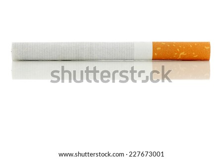 Cigarette lying on a shiny surface.