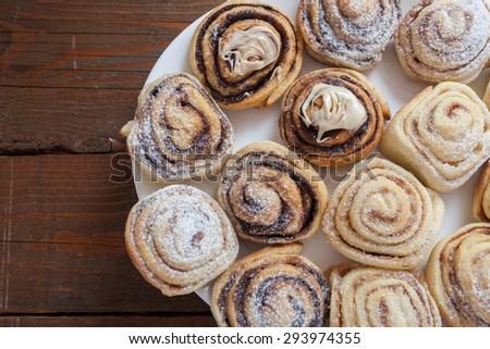 Cinamon and chocolate rolls cake - stock photo
