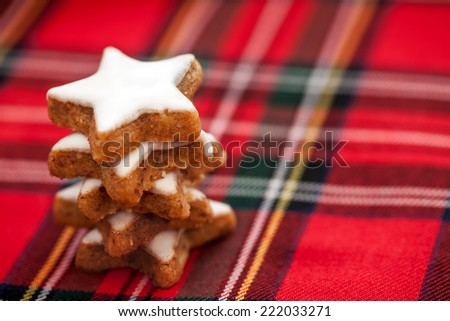 Cinnamon stars stack on checkered background - stock photo