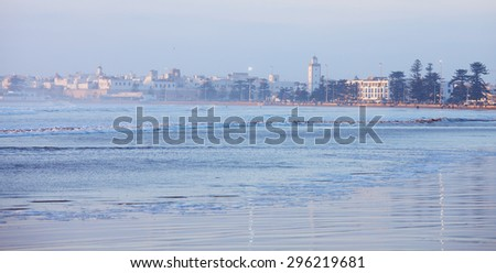 City and Wilaya  in  mist  at sunset., view from the beach.  Essaouira , Morocco.  - stock photo