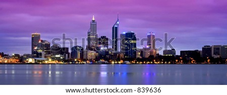 city at dusk with beautiful reflections - stock photo