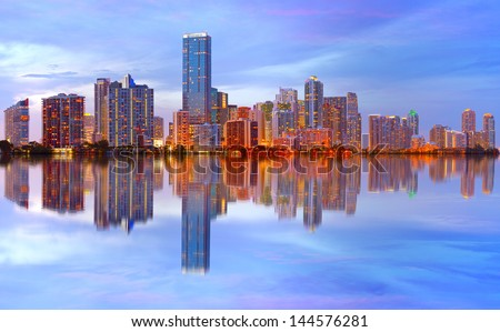 City of Miami Florida sunset over downtown illuminated business and luxury residential buildings, hotels with reflection .Night Cityscape of World famous travel location. - stock photo
