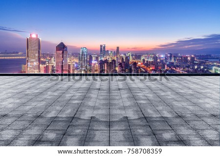 cityscape and skyline of downtown near water of chongqing at night