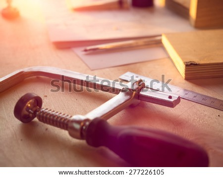 Clamp with sunflare at background - stock photo