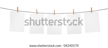 5 clean sheets on clothesline with clothespins isolated on white background - stock photo