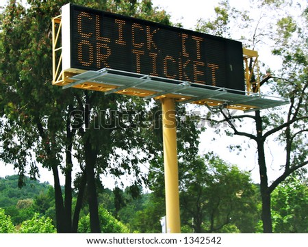 """""""Click It or Ticket"""" driver advisory sign on California State Highway 24, warning them to wear their seatbelts. - stock photo"""