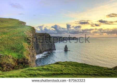 Cliffs of Moher at sunset in Ireland. - stock photo