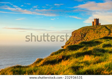 Cliffs of Moher - O Briens Tower castle at sunset  in Co. Clare Ireland Europe. - stock photo