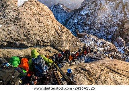climbers traversing a steep slope covered with snow.seoul,Korea - stock photo