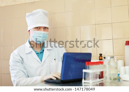 clinician during scientific experiment in laboratory - stock photo