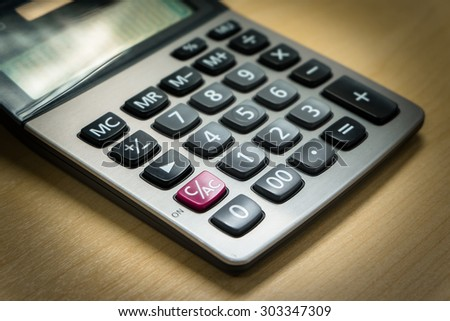 close up calculator buttons with vignette background - stock photo