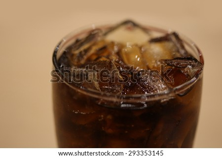 close up ice in cola glass - stock photo