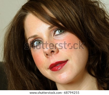 Close-up image of young beautiful caucasian female - stock photo