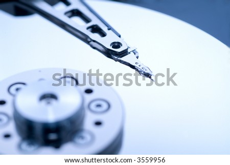 close up macro of an opened computer harddrive. - stock photo