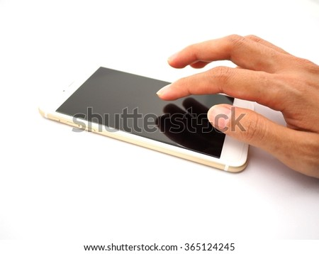 Close up of a Human hand using smartphone - stock photo