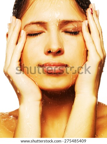 Close-up of beautiful wet woman face with water drop. On white background  - stock photo