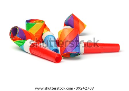 Close up of colorful party blowers on white background - stock photo
