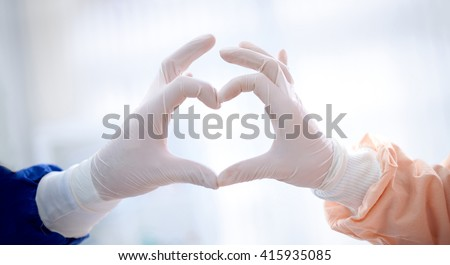 close up of doctors hands  making heart shape, cardiology concept - stock photo