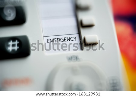Close-up of emergency button on a modern phone with shallow depth-of-field - stock photo