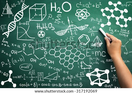 close up of formulas on a blackboard - stock photo