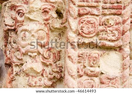 Close up of hieroglyphs and carvings on Stela C at the ancient Mayan city of Copan. Honduras, Central America. - stock photo