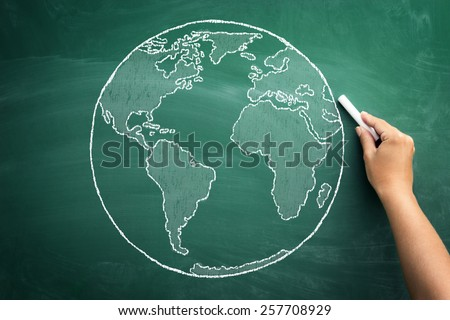 Close up of human hand drawing idea of global business on blackboard - stock photo