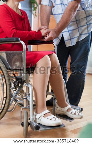 close up of invalid  woman's hands  near senior man. - stock photo