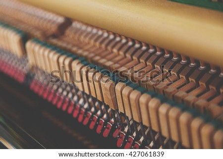 close up of mechanics inside of an upright piano - stock photo