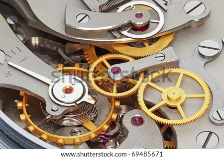 Close-up of metal clock works. - stock photo