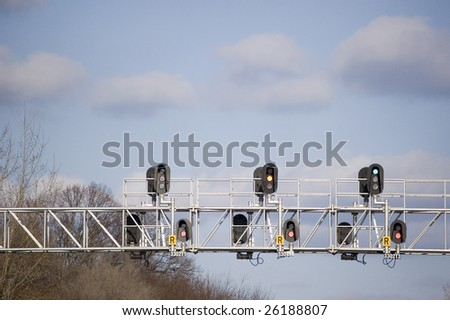 close up of  railroad trafficlight on a  crossroad - stock photo