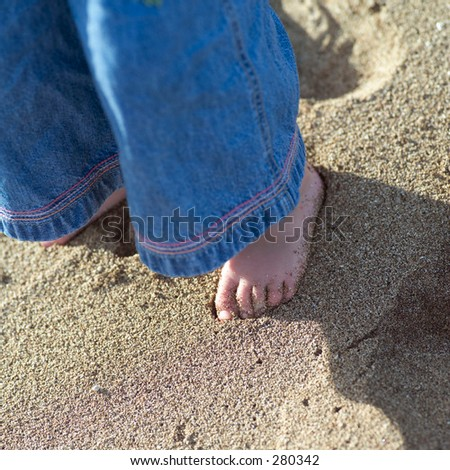 """Close-up of the feet of a young girl standing in sand, Kauai, Molokai, Hawaii, (Keith Levit)"""
