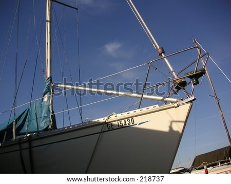 Close-up of the front part of a yacht, against the sky
