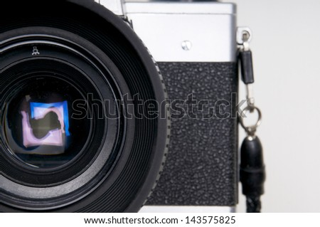 Close up of the lens of an vintage camera - stock photo