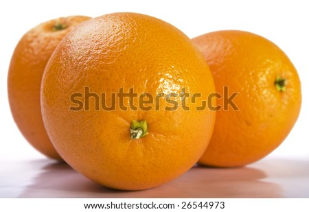 Close up of three fresh oranges on white background