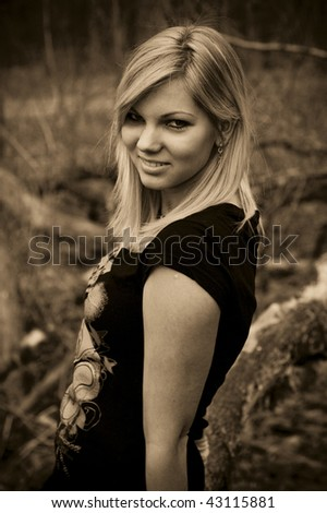 close-up photo of beautiful young girl in the forrest