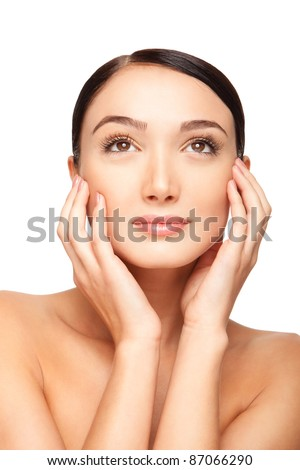 Close up portrait of a beautiful female  model. Holding hands around the face