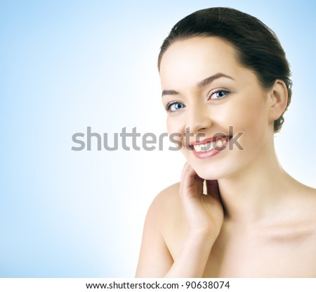 Close up portrait of a female model with beautiful blue eyes - stock photo