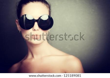 Close-up portrait of pretty girl in sunglasses - stock photo