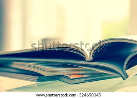 close up stacking of magazine with extremely DOF , vintage color tone - stock photo