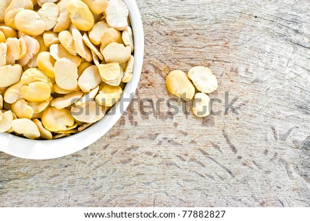 ,Close up view of fave bean in white bowl on wood background, - stock photo