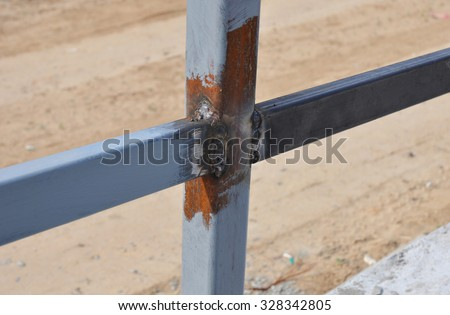 Close up Weld on a Steel Iron Bar for a New Fence Frame. Welding is a Fabrication or Sculptural Process That Joins Materials, Usually Metals or Thermoplastics, by Causing Fusion. - stock photo