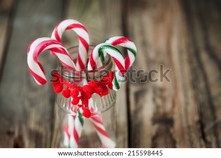closeup christmas sweet candy in the glass on the background - stock photo
