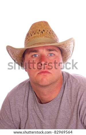 closeup head shot of an attractive  young man in straw cowboy hat
