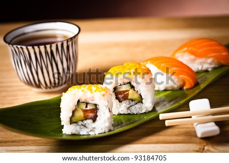 Closeup japanese sushi on a leaf - stock photo