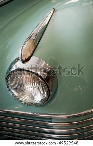 closeup of headlight of old car - stock photo