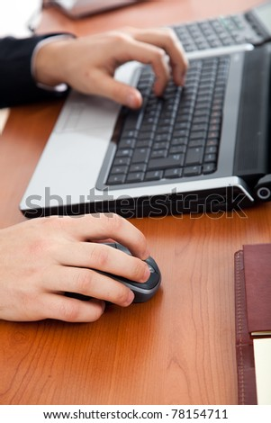 Closeup of male hand typing on a computer keyboard