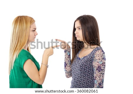Closeup of two teenage girls having a fight over white background - stock photo