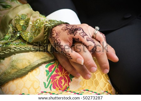 Closeup of wedding couple's hands - stock photo