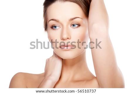 Closeup portrait of beautiful female model with blue eyes on white background - stock photo