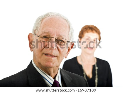 closeup  portrait off a senior businessman with colleague in the background isolated on white - stock photo